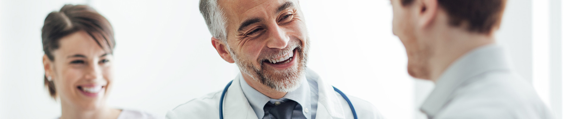 Doctors smiling because of healthcare document management